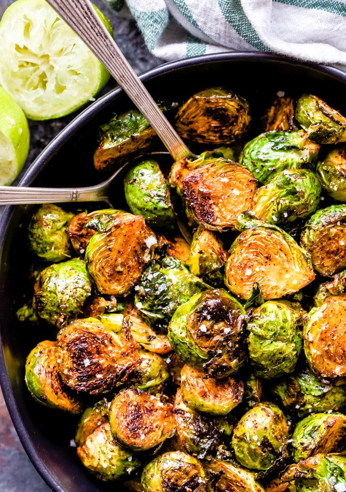You'll love the savory sweet flavor of these Chili Honey Lime Roasted Brussels Sprouts! Tender with crispy edges and Southwest flavor, they'll be your new favorite way to roast brussels sprouts! #brusselssprouts #honeylime #chili #sidedish #healthyrecipe #glutenfree #paleo