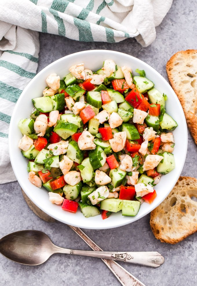 This Cucumber Shrimp Salad with Lemon and Herbs is bright, fresh and full of flavor! Made with simple, healthy ingredients and it couldn't be easier to make! #salad #shrimp #shrimpsalad #cucumber #easyrecipe #glutenfree #paleo #whole30