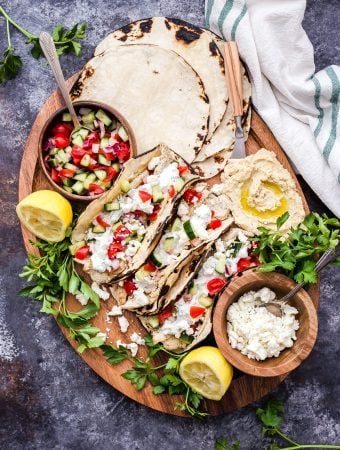 If you love Greek food and tacos you won't be able to resist these Greek Chicken Tacos with Tzatziki and Hummus! Fresh, healthy and loaded with all your favorite Greek flavors! #tacos #chicken #Greekchicken #Greekfood #dinner #glutenfree #healthyrecipes #tzatziki #hummus