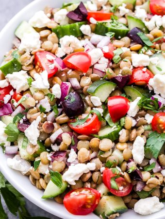 This Mediterranean Lentil Salad is a hearty salad that's perfect for lunch, a side dish or even a vegetarian main dish. Full of cucumbers, tomatoes, olives, feta and protein packed lentils. You'll absolutely love the flavors and textures in this healthy salad! #salad #mediterranean #mediterraneandiet #lentils #vegetarian #glutenfree #healthyrecipe