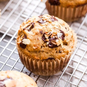 Coconut Chocolate Chunk Banana Muffins are wonderful for a weekend breakfast or brunch! These tender banana muffins studded with just the right amount of toasted coconut and dark chocolate chunks will go perfect with your cup of coffee. #muffins #bananamuffins #banana #chocolate #coconut #breakfast #brunch