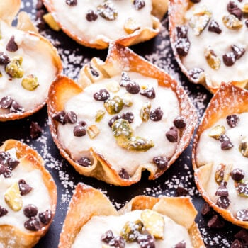Pistachio Chocolate Chip Cannoli Cups are the easiest way to get your cannoli fix without all the work! Made with lighter ingredients and baked instead of fried, they're perfect for parties or any special occasion.#cannoli #ricotta #dessert #valentinesday #partyfood #chocolatechips #pistachio