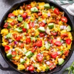 This Southwest Turkey and Egg Breakfast Skillet is a delicious and filling way to start your day! Southwest seasoned ground turkey and scrambled eggs are topped with cheese, tomatoes, avocado, cilantro and salsa. It's perfect for meal prep, a weekend breakfast or even dinner! #breakfastskillet #scrambledeggs #groundturkey #lowcarb #glutenfree #mexicanfood #skillet