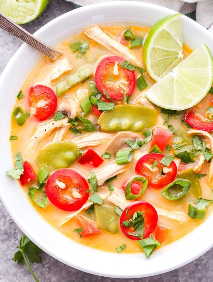 This Thai Chicken Soup is bursting with fresh and spicy flavors! Lightly creamy and perfect for lunch or an easy weeknight dinner! #soup #chickensoup #thairecipe #thai #glutenfree #healthyrecipe