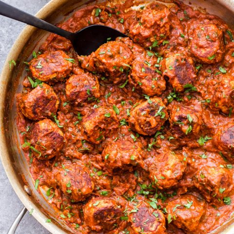 Skillet Chicken Tikka Masala Meatballs are a fun twist on the popular Indian dish. Chicken meatballs are simmered in a creamy and flavorful tikka masala sauce and served over rice for a cozy, ethnic meal. #tikkamasala #meatballs #chickenrecipe #chickentikkamasal #indianfood #skillet #dinner #glutenfree #dairyfree