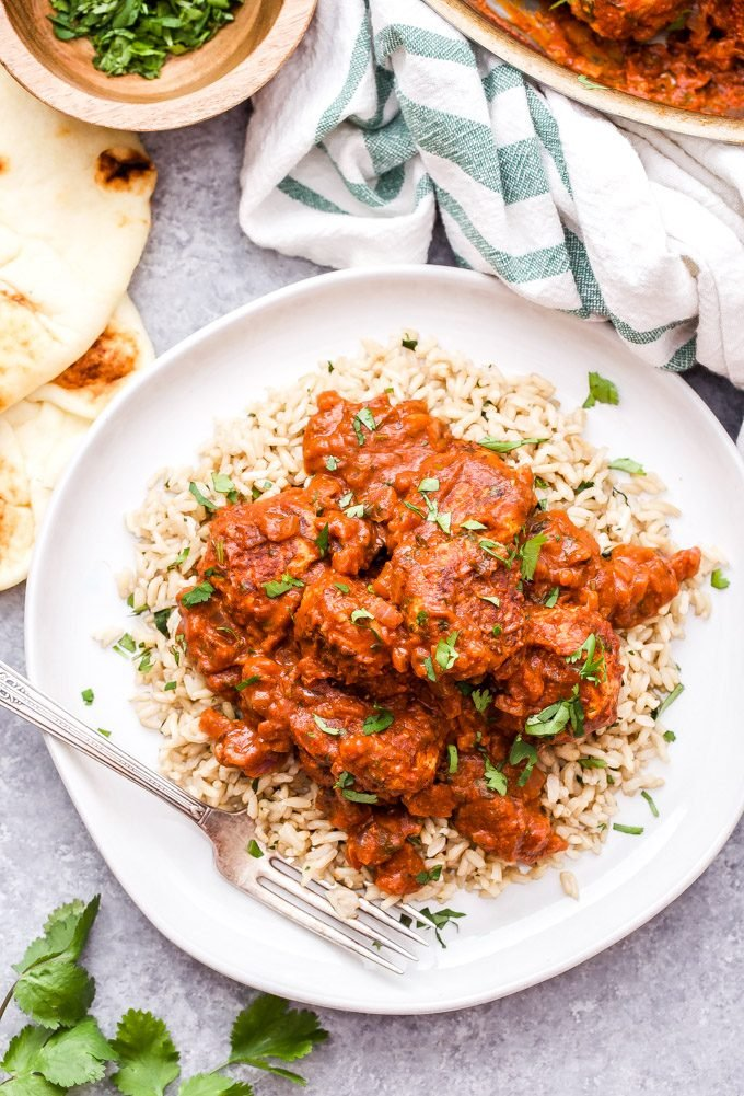 Skillet Chicken Tikka Masala Meatballs are a fun twist on the popular Indian dish. Chicken meatballs are simmered in a creamy and flavorful tikka masala sauce and served over rice for a cozy, ethnic meal.#tikkamasala #meatballs #chickenrecipe #chickentikkamasal #indianfood #skillet #dinner #glutenfree #dairyfree
