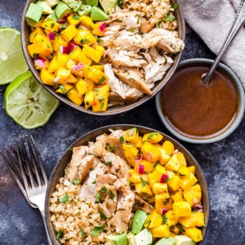Two Cauliflower Rice Fish Taco Bowls with small bowl of vinaigrette