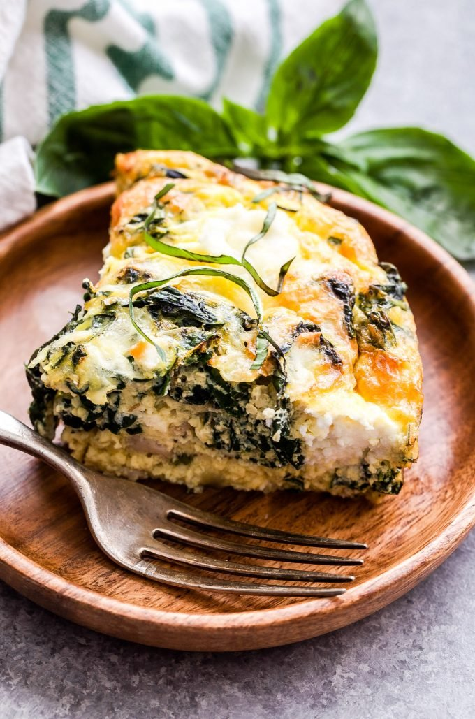 Crustless Sausage, Kale and Ricotta Quiche on wooden plate