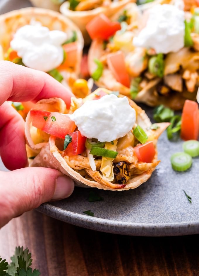 Mini Chicken Enchilada Cups in hand