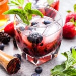 Mixed Berry Mint Julep with muddler, mint and berries