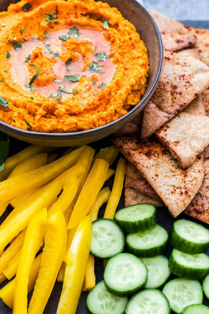 Paleo Roasted Carrot and Sweet Potato Hummus on platter with veggies and pita