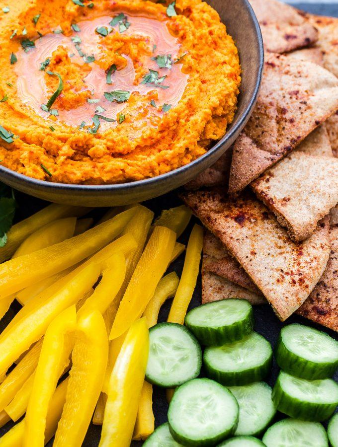 Paleo Roasted Carrot and Sweet Potato Hummus on platter with veggies and pita