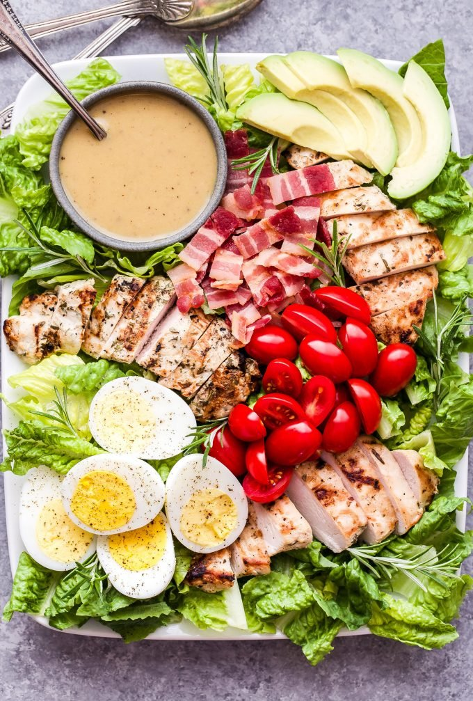 Grilled Rosemary Chicken Salad with Honey Mustard Dressing on white platter
