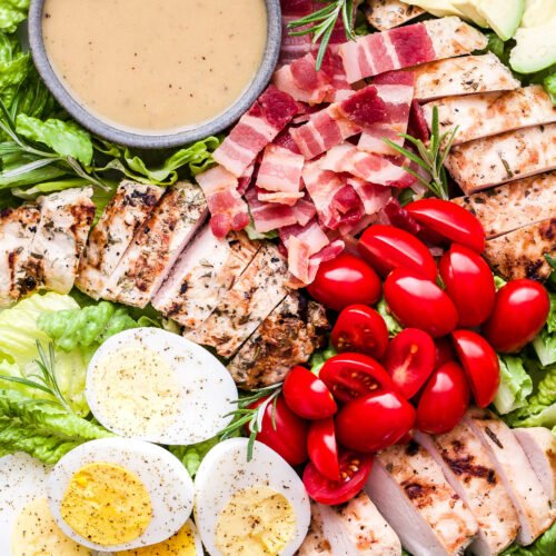 Grilled Rosemary Chicken Salad with Honey Mustard Dressing in small grey bowl