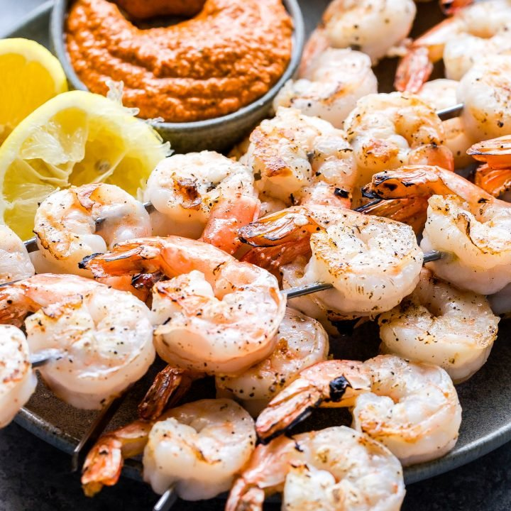 Grilled Shrimp with Romesco Sauce in small gray bowl