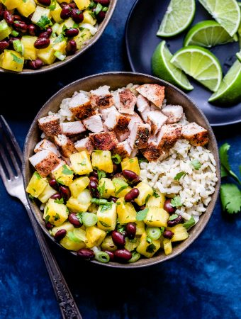 Jerk Chicken Bowls with Pineapple Black Bean Salsa in brown bowl
