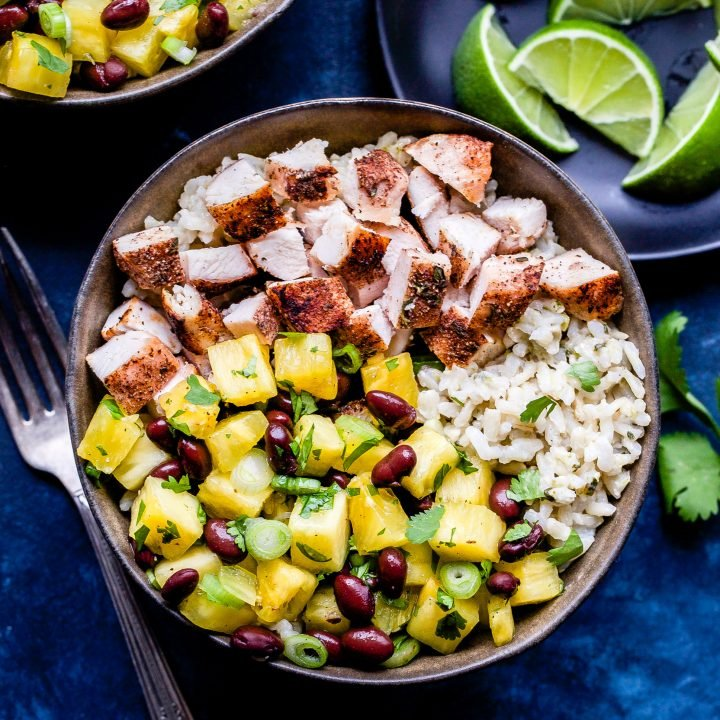 Jerk Chicken Bowls with Pineapple Black Bean Salsa in brown bowl