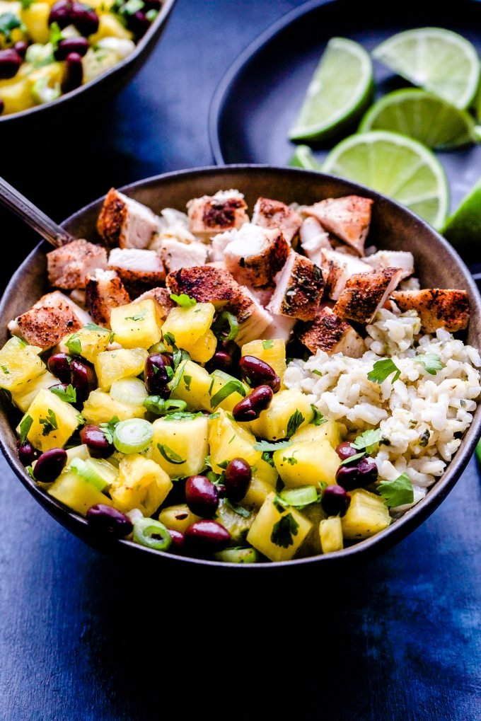 Jerk Chicken Bowls with Pineapple Black Bean Salsa with fork in the bowl