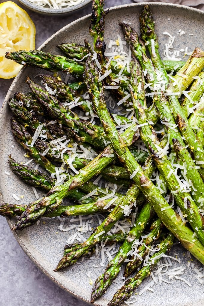 Lemon Parmesan Grilled Asparagus on plate sprinkled with parmesan cheese