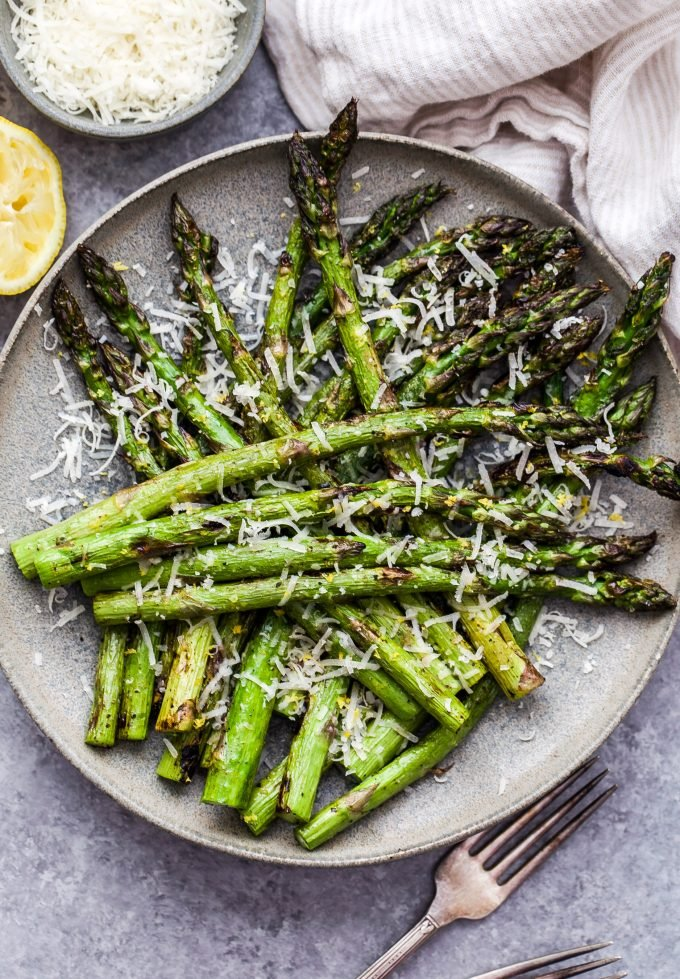 Lemon Parmesan Grilled Asparagus on gray plate with fork