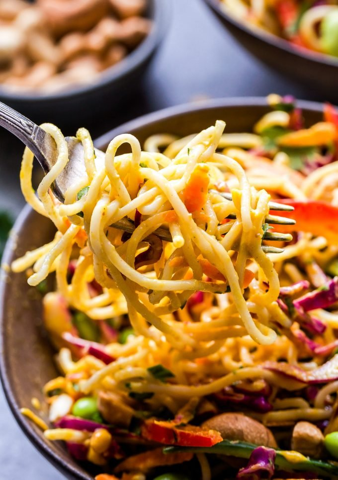 Thai Noodle Salad with Cashew Carrot Ginger Sauce scooped out with a fork