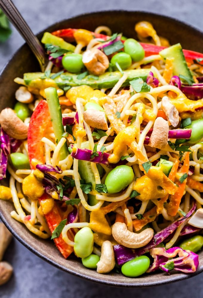 Thai Noodle Salad with Cashew Carrot Ginger Sauce in bowl with fork