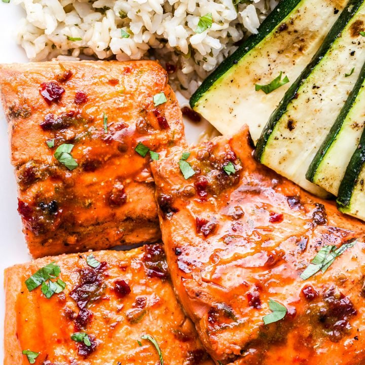 Closeup of Chipotle Maple Grilled Salmon with grilled zucchini and rice