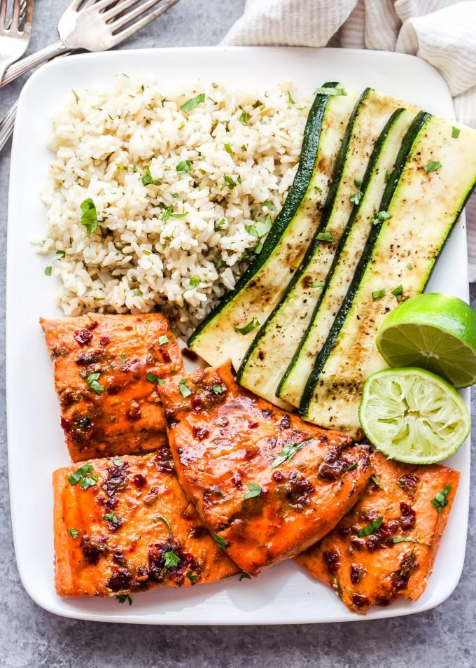 Chipotle Maple Grilled Salmon on white plate with cilantro lime rice and zucchini