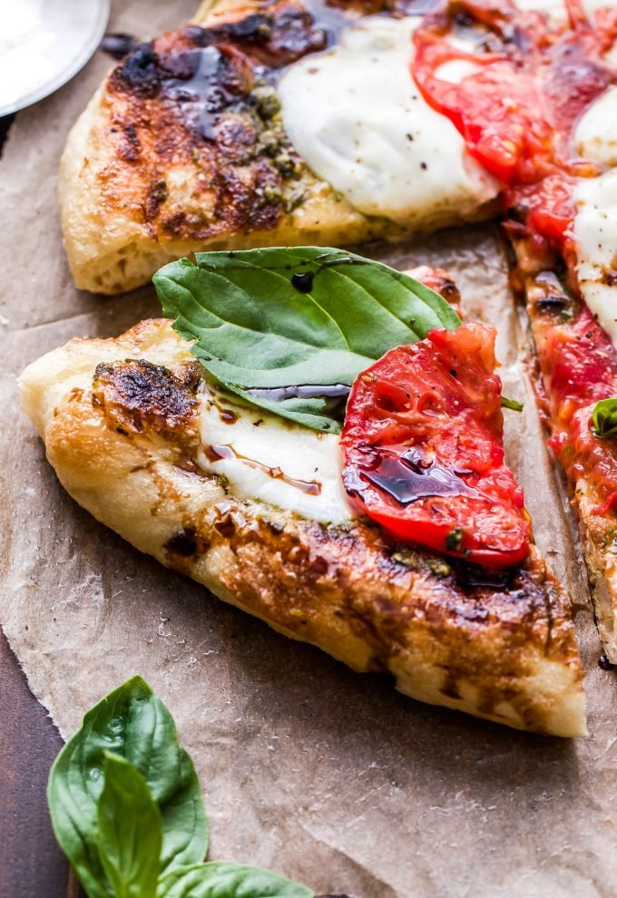 A slice of the Grilled Caprese Pizza