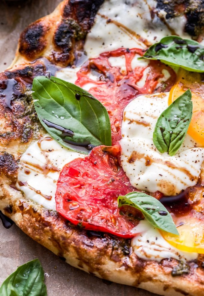 Grilled Caprese Pizza on parchment paper