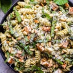 Grilled Chicken and Asparagus Pesto Pasta garnished with basil and pine nuts.