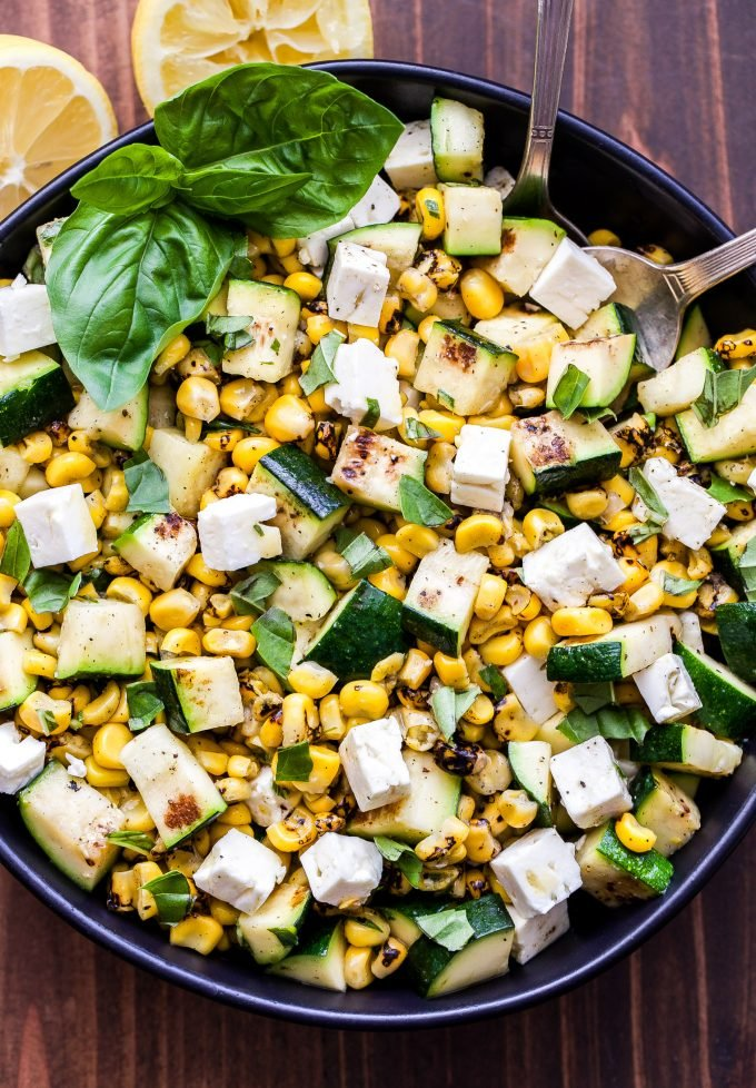 Grilled Zucchini Corn Salad with Lemon Basil Vinaigrette overhead photo with lemons on the side