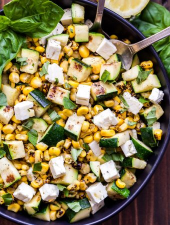 Grilled Zucchini Corn Salad with Lemon Basil Vinaigrette in black bowl