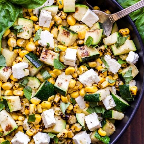 Grilled Zucchini Corn Salad with Lemon Basil Vinaigrette in black bowl