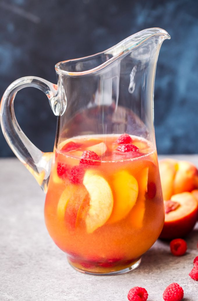 Pitcher filled with Peach Rosé Sangria