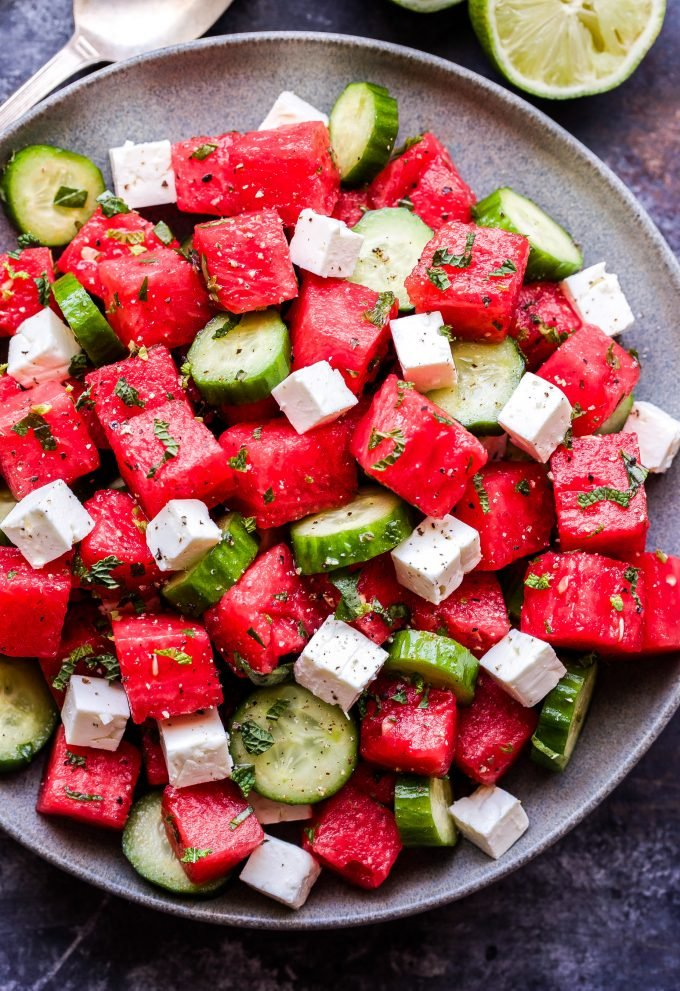 Watermelon Salad with Cucumber and Feta on grey plate.