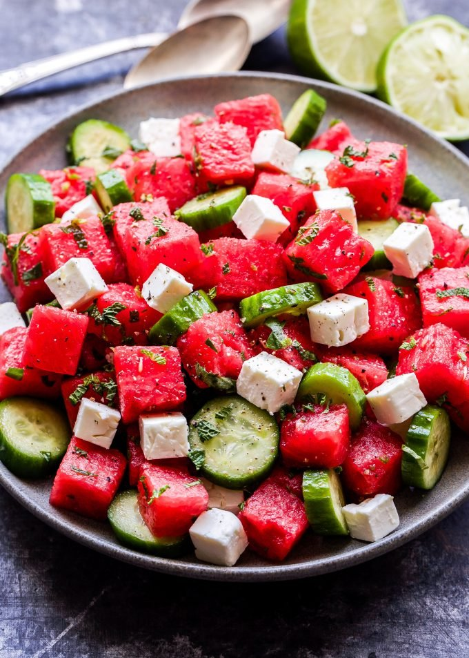 Watermelon Salad with Cucumber and Feta on gray plate with a halved lime next to the plate