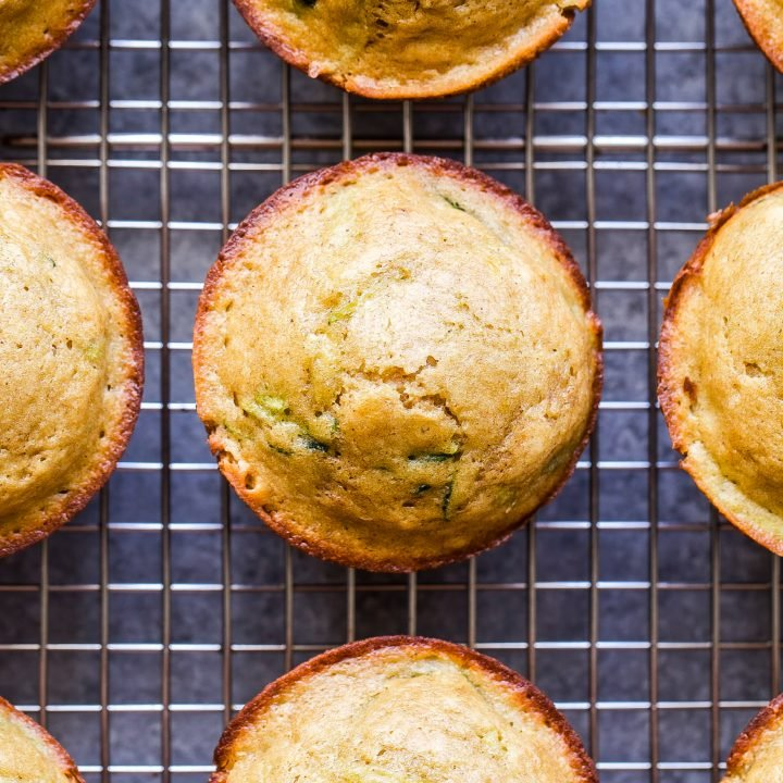 overhead photo of Lemon Zucchini Muffins on wire cooling rack.