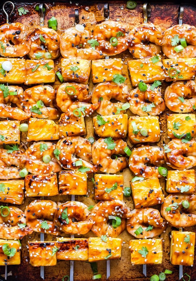 Teriyaki Shrimp and Pineapple Skewers on a sheet pan.