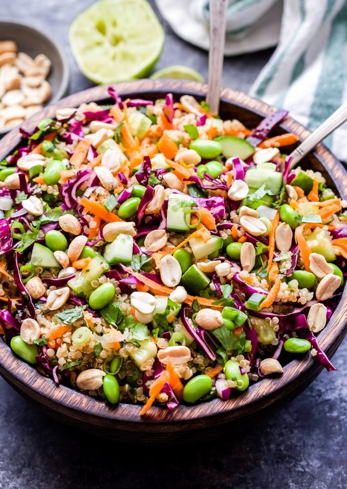 Thai Quinoa Salad in wooden bowl with serving spoons.