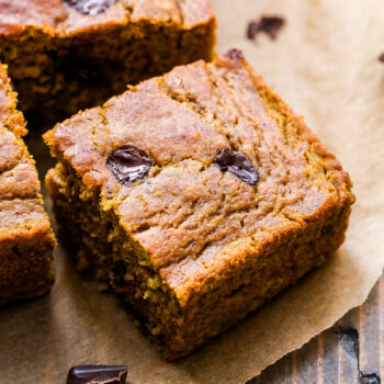 Pumpkin Chocolate Chunk Cake square slice on parchment paper.
