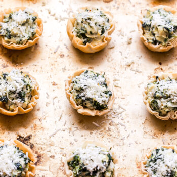 Spinach Artichoke Dip Phyllo Cups on sheet pan.