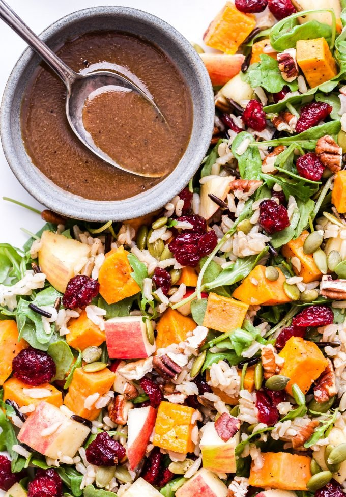 Sweet Potato, Wild Rice and Arugula Salad with dried cranberries, pecans and a bowl of balsamic maple vinaigrette.