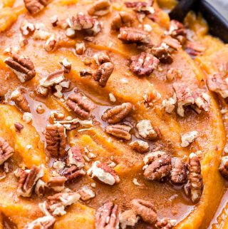 Cinnamon Maple Mashed Sweet Potatoes and Butternut Squash topped with chopped pecans, maple syrup and cinnamon.
