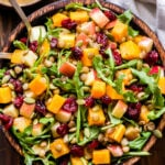 Overhead photo of Butternut Squash Lentil Salad with cranberries, arugula, pepitas, apples in a wooden bowl.