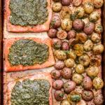 Sheet Pan Pesto Salmon and Potatoes side by side on a sheet pan.