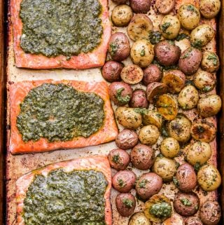 Sheet Pan Pesto Salmon and Potatoes side by side on a sheet pan.