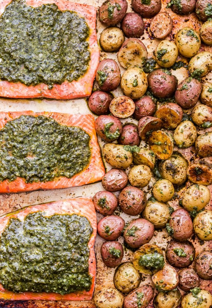 Sheet Pan Pesto Salmon and Potatoes on rimmed sheet pan.