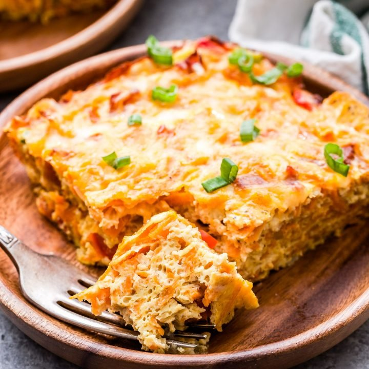 Sweet Potato, Bacon and Egg Breakfast Casserole with piece cut off and on a fork.