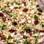 Sun Dried Tomato Quinoa Salad in serving bowl with feta, pine nuts and parsley.